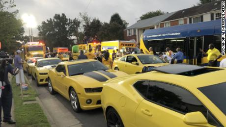 A view of the street with all the yellow vehicles.