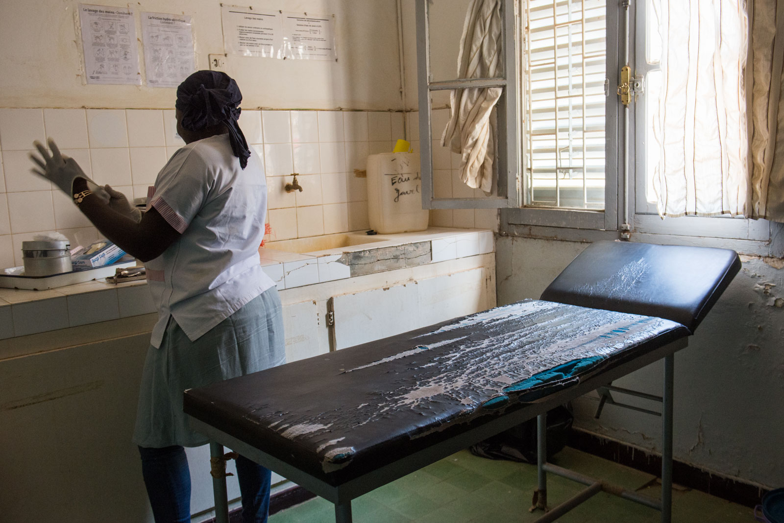 A midwife at the clinic in the Dakar suburb of Sébikhotane prepares medical equipment to examine a registered sex worker