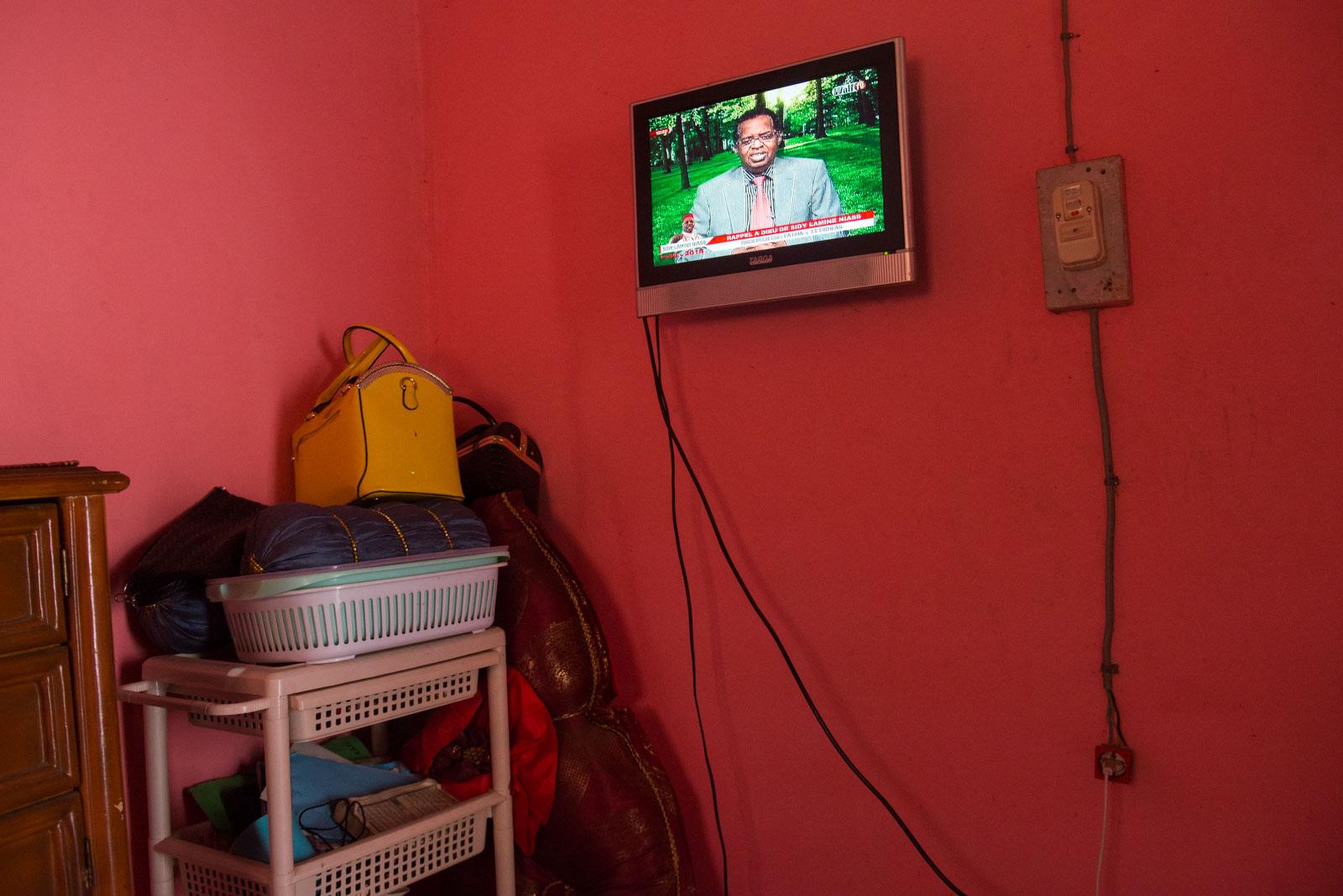 A news broadcast plays on a TV in Khadija's bedroom