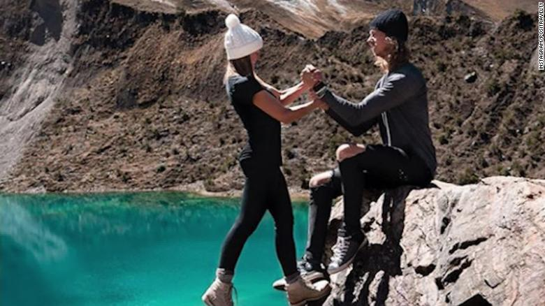 Travel influencer couple defends death-defying photo
