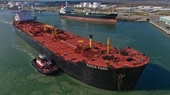 The Eagle Ford crude oil tanker sails out of the the NuStar Energy dock at the Port of Corpus Christi in Corpus Christi, Texas, U.S., on Thursday, Jan. 7, 2016. Crude oil slid Thursday to the lowest level since December 2003 as turbulence in China, the worlds biggest energy consumer, prompted concerns about the strength of demand. Photographer: Eddie Seal/Bloomberg via Getty Images