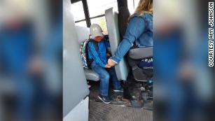 He was nervous about the first day of school, so his school bus driver held his hand for support