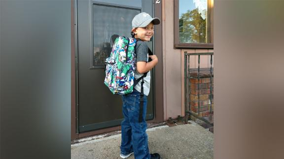 Axel before heading off to the bus stop on the first day of school.