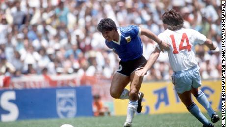 Diego Maradona beats England defender Terry Fenwick on his way to scoring his outstanding individual second goal in the 1986 World Cup quarterfinal.