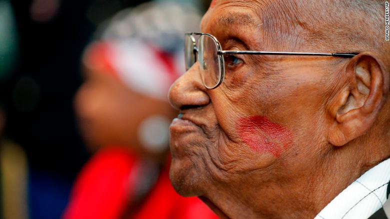 Lawrence Brooks sports a lipstick kiss on his cheek as he celebrates his 110th birthday at the National World War II Museum.