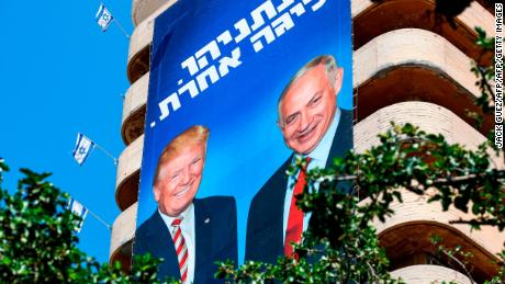 "This picture taken on July 28, 2019 shows two giant Israeli Likud Party election banners hanging from a building showing Israeli Prime Minister Benjamin Netanyahu shaking hands with US President Donald Trump, with a caption above reading in Hebrew ""Netanyahu, in another league"", in the coastal Mediterranean city of Tel Aviv. (Photo by JACK GUEZ / AFP)        (Photo credit should read JACK GUEZ/AFP/Getty Images)"