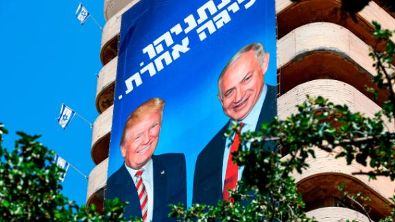 Israeli Likud Party election banners show Israeli Prime Minister Benjamin Netanyahu shaking hands with US President Donald Trump.