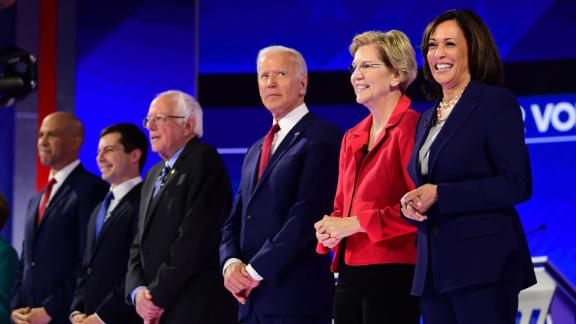 Democratic presidential hopefuls (L-R) Senator of New Jersey Cory Booker, Mayor of South Bend, Indiana, Pete Buttigieg, Senator of Vermont Bernie Sanders, Former Vice President Joe Biden, Senator of Massachusetts Elizabeth Warren and Senator of California Kamala Harris arrive onstage for the third Democratic primary debate.