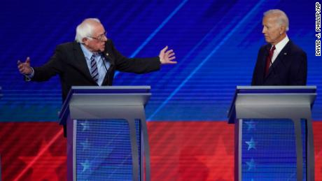 Former Vice President Joe Biden, right, listens as Sen. Bernie Sanders, I-Vt., left, speaks Thursday, Sept. 12, 2019, during a Democratic presidential primary debate hosted by ABC at Texas Southern University in Houston. (AP Photo/David J. Phillip)