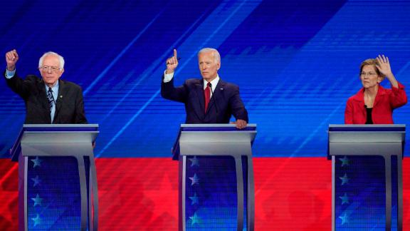 From left, Democratic presidential candidates Sen. Bernie Sanders, I-Vt., former Vice President Joe Biden and Sen. Elizabeth Warren, D-Mass. raise their hands to answer a question Thursday, Sept. 12, 2019, during a Democratic presidential primary debate hosted by ABC at Texas Southern University in Houston. (AP Photo/David J. Phillip)