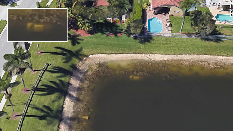The submererged car is on the top left side of the pond. See inset.
