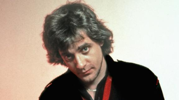 """Eddie Money, the singer and songwriter that was known for hits from the 1970's and 1980's such as """"Baby Hold On"""" and """"Take Me Home Tonight,"""" died September 13 following complications from esophageal cancer, his family announced. He was 70."""