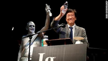Shigeru Watanabe, of Japan, receives the Ig Nobel award in chemistry for estimating the total saliva volume produced per day by a typical five-year-old, at the 29th annual Ig Nobel awards ceremony at Harvard University.