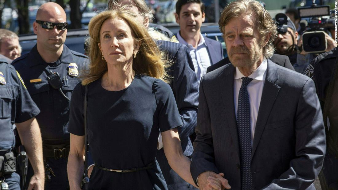 Felicity Huffman reports to prison to start two-week sentence for admissions scam