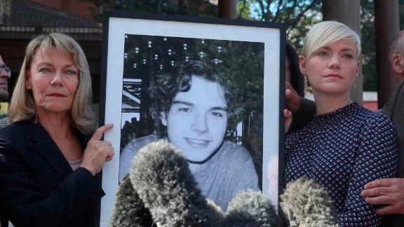 Owen Carey's family with a picture of the teenager, outside Southwark Coroner's Court on Friday.