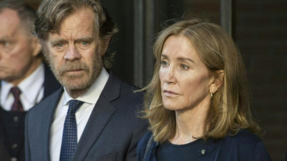 Actress Felicity Huffman, escorted by her husband William H. Macy (L), exits the John Joseph Moakley United States Courthouse in Boston, where she was sentenced by Judge Talwani for her role in the College Admissions scandal on September 13, 2019. - Actress Felicity Huffman gets 14 days jail in US college admissions scandal (Photo by Joseph Prezioso / AFP)        (Photo credit should read JOSEPH PREZIOSO/AFP/Getty Images)