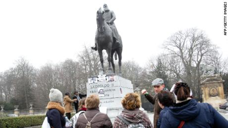 Protesters gather at a statue of Leopold II in Brussels.