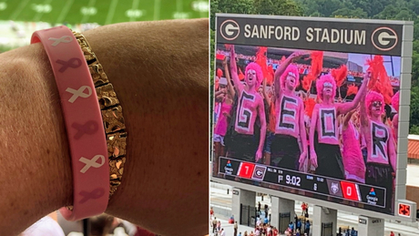 Hannah Kay Herdlinger attended the game with Jim Davies, who snapped a photo of her pink wristband.