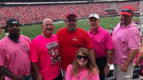 Dwight Standridge, second from left, and other UGA fans wear pink to support in support of Arkansas State coach Blake Anderson, who lost his wife to cancer last month.