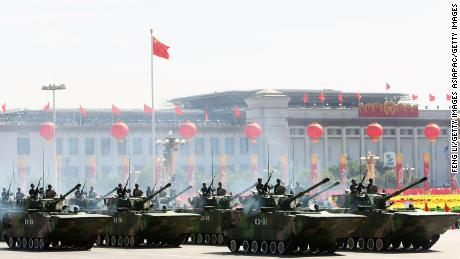Chinese tanks rumble past Tiananmen Square to celebrate the 60th anniversary of the founding of the People's Republic of China in Beijing on October 1, 2009.