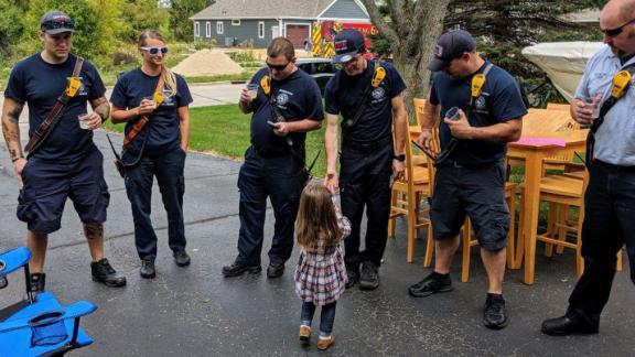 Lainie serving lemonade to the Germantown Fire Department.