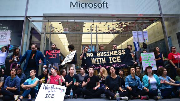Protestors block the entrance of a Microsoft store in midtown Manhattan during a rally against the US immigration policy on September 14, 2019 in New York City. Some dozens protesters were arrested by the police after blocking the 5th Avenue.