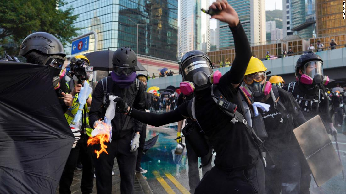 An anti-government protester throws a Molotov cocktail during a demonstration near Central Government Complex in Hong Kong on Sunday, September 15.