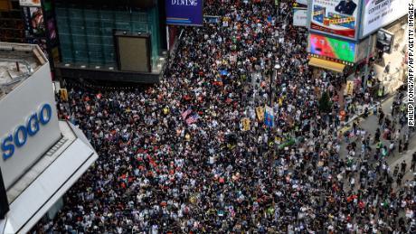 Protesters attend a pro-democracy march in the Causeway Bay district of Hong Kong on September 15, 2019. - Millions of people have taken part in demonstrations over the last three months which have morphed into calls for democracy and complaints against the erosion of freedoms under Beijing's rule. (Photo by Philip FONG / AFP)        (Photo credit should read PHILIP FONG/AFP/Getty Images)