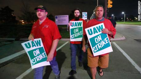 United Auto Workers members picket outside the General Motors Detroit-Hamtramck assembly plant in Hamtramck, Michigan early on Monday.