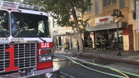 Four San Jose firefighters were injured in a fire they suspect was intentionally set by a disgruntled former employee or former tenant of a commercial building in downtown San Jose, fire officials say.