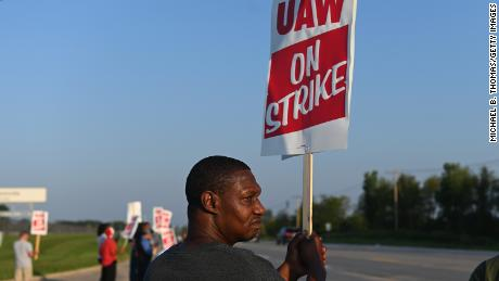 WENTZVILLE, MO - SEPTEMBER 16: A man of the Local 2250 United Auto Workers Union picket outside the General Motors Assembly Plant on September 16, 2019 in Wentzville, Missouri. Nearly 50,000 members of the United Auto Workers went on strike after their contract expired and the two parties could not come to an agreement. (Photo by Michael B. Thomas/Getty Images)