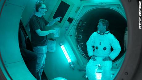 "James Gray (left) directs Brad Pitt (right) on the set of upcoming sci-fi thriller ""Ad Astra."""