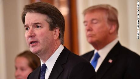Supreme Court nominee Brett Kavanaugh (L) speaks as US President Donald Trump listens after he announced his nomination in the East Room of the White House on July 9, 2018 in Washington, DC. (Photo by MANDEL NGAN / AFP)        (Photo credit should read MANDEL NGAN/AFP/Getty Images)