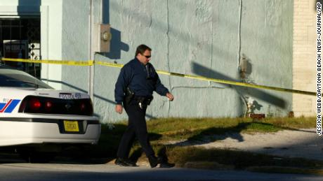 Police Lt. Steven Beres walks by the alley where Laquetta Gunther's body was found in 2005.