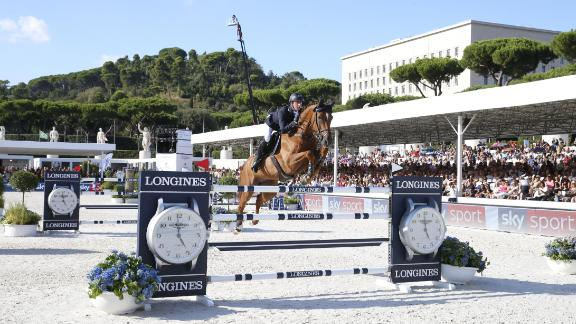 Britain's Ben Maher, the defending overall champion, clinched the Rome Grand Prix to climb to the top of the season standings.