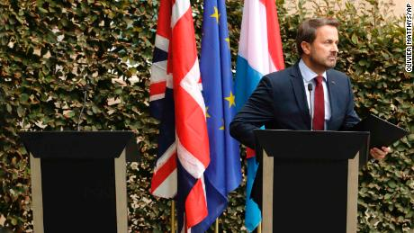 Xavier Bettel addresses the meida next to an empty lectern intended for British Prime Minister Boris Johnson.