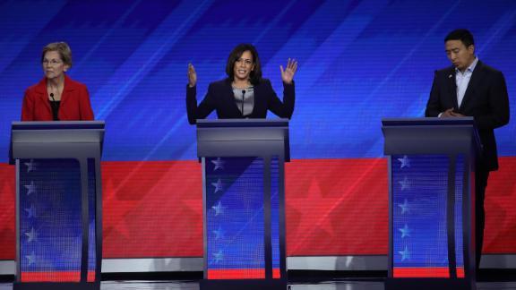 Candidates Elizabeth Warren, Kamala Harris and Andrew Yang during the Democratic presidential debate on September 12, 2019, in Houston.