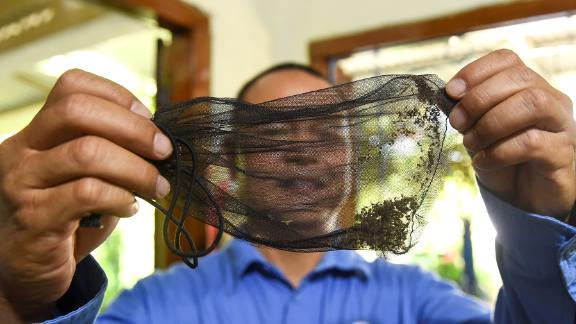Field officer Luu Quoc Hung from the World Mosquito Program holds a bag of mosquitoes in the southern Vietnamese city of Nha Trang.