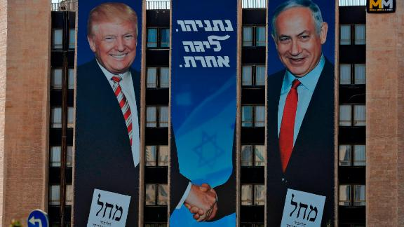 An election banner on a Jerusalem building shows Netanyahu shaking hands with US President Donald Trump. Trump remains incredibly popular in Israel — far more popular than he is in the United States.