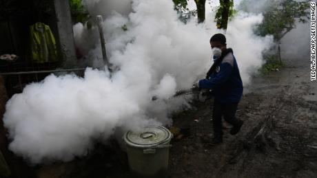A municipal employee operates a fog machine to kill mosquito larvae to combat the spread of dengue in a village in Antipolo, Rizal province, east of Manila. A municipal employee operates a fog machine to kill mosquito larvae to combat the spread of dengue in a village in Antipolo, Rizal province, east of Manila.
