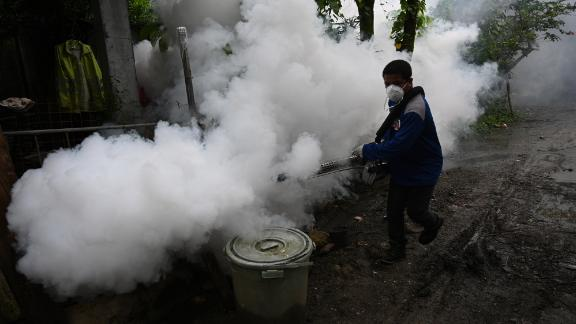 A municipal employee operates a fogging machine to kill mosquito larvae to fight the spread of dengue at a village in the town of Antipolo, Rizal province, east of Manila.