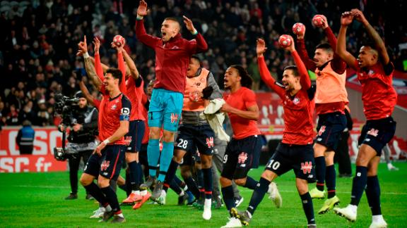 Lille's players celebrate hammering PSG 5-1 towards the end of last season.