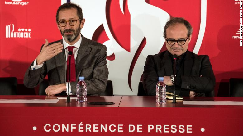Marc Ingla (L) and Luis Campos (R) take part in a press conference for Lille.