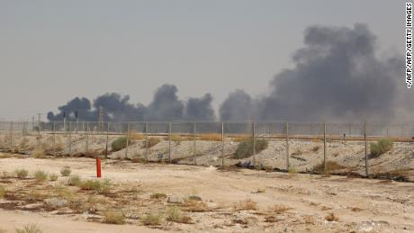 Smoke billows from an Aramco oil facility in Abqaiq about 60km (37 miles) southwest of Dhahran in Saudi Arabia's eastern province on September 14, 2019. - Drone attacks sparked fires at two Saudi Aramco oil facilities early today, the interior ministry said, in the latest assault on the state-owned energy giant as it prepares for a much-anticipated stock listing. Yemen's Iran-aligned Huthi rebels claimed the drone attacks, according to the group's Al-Masirah television. (Photo by - / AFP)        (Photo credit should read -/AFP/Getty Images)
