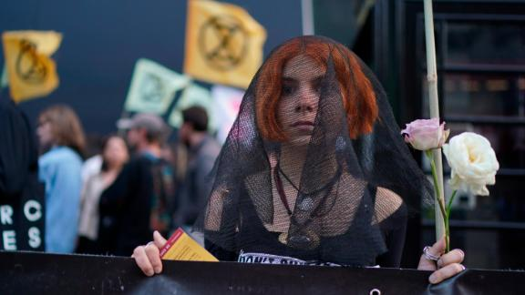 Extinction Rebellion protest at London fashion Week. Protesters from Extinction Rebellion demonstrate outside the BFC Show Space, London. Picture date: Tuesday September 17, 2019. Photo credit should read: Isabel Infantes/PA Wire URN:45330330 (Press Association via AP Images)