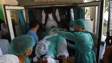 A wounded man is transported in an ambulance at the Wazir Akbar Khan hospital.