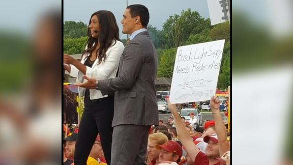 Iowa State fan Carson King holding up a sign asking for beer money at the College Gameday set this past Saturday in Ames Iowa. He's received more than $13,000 so far.  CNN Obscured part of this image to remove King's Venmo address.