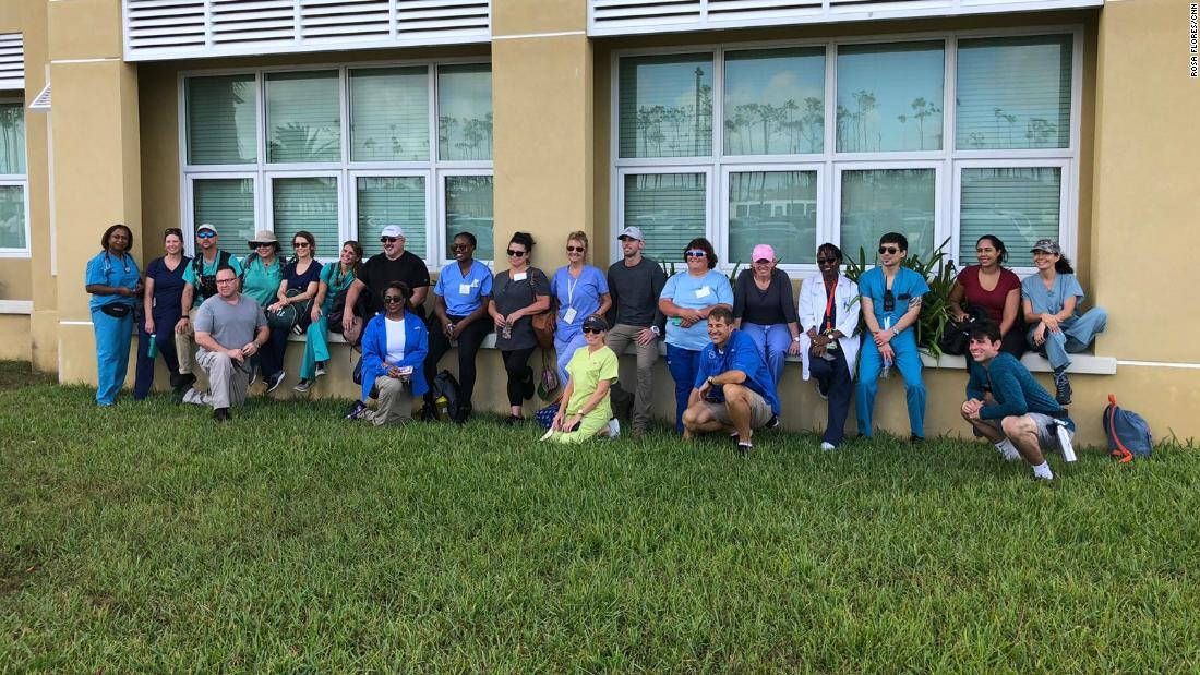 Some of the medics gather in front of an emergency operations center in Freeport, Bahamas.
