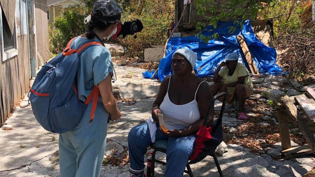 A volunteer medic speaks to a hurricane survivor on battered Grand Bahama Island.
