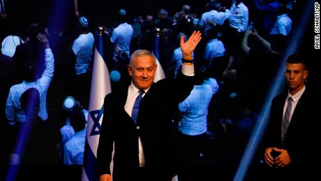 Benjamin Netanyahu addresses his supporters at the Likud Party headquarters after elections in Tel Aviv.